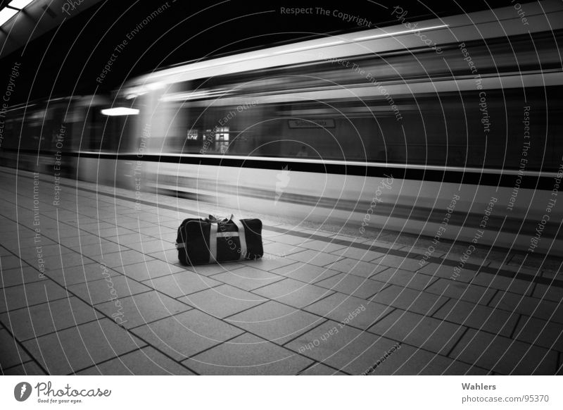 suitcase bomb Subsoil Underground London Underground Bag Stuttgart Railroad White Black Dark Mysterious Criminality Assault Bomb Suitcase Motion blur Blur