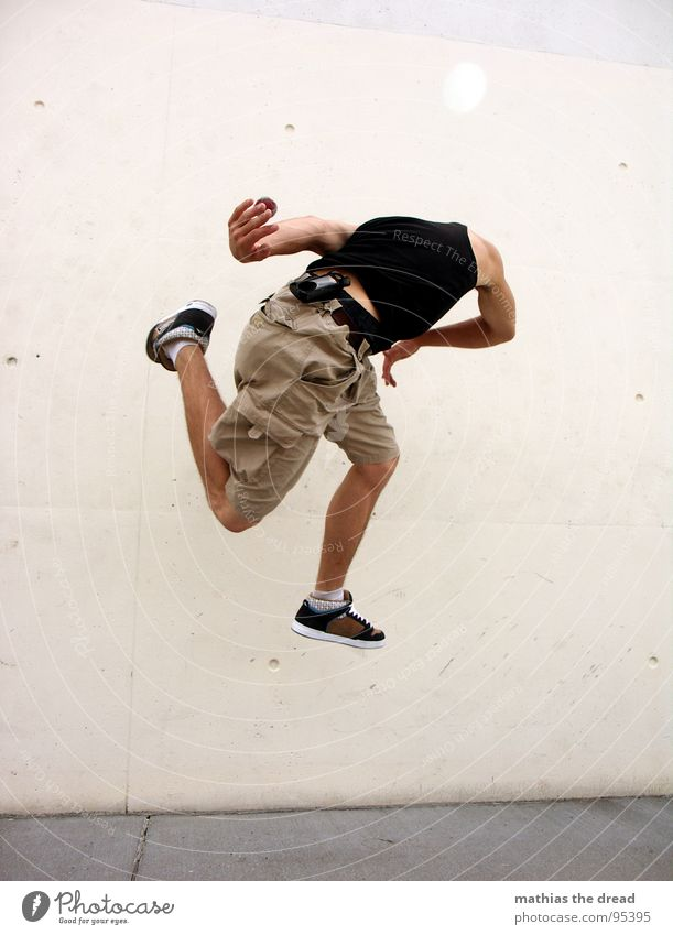 Man Youth (Young adults) Wall (building) Playing Movement Jump Style Healthy Background picture Leisure and hobbies Tall Masculine Aviation Action Ball