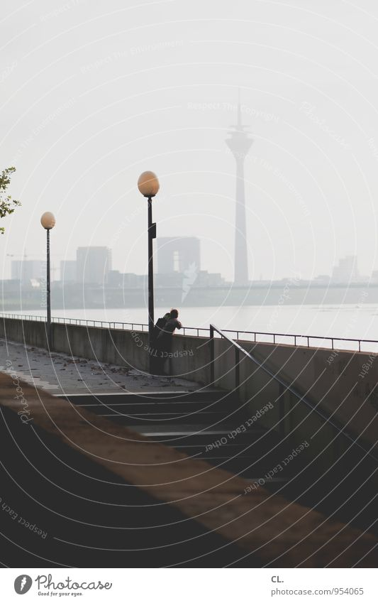 Düsseldorf Leisure and hobbies Human being Sky Fog River Rhine Duesseldorf Town Skyline Wall (barrier) Wall (building) Stairs Tourist Attraction Landmark