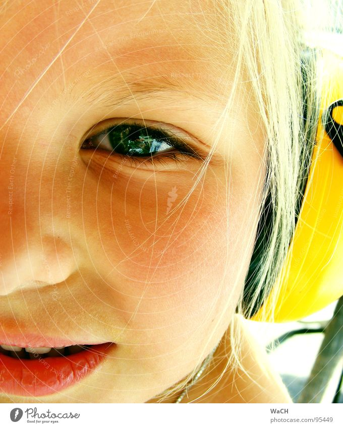 Jenny p-1 Child Girl Headphones Ear protectors Yellow Blonde Summer Listening Toddler Eyes Mouth Bright jenny Jennifer Looking Snapshot