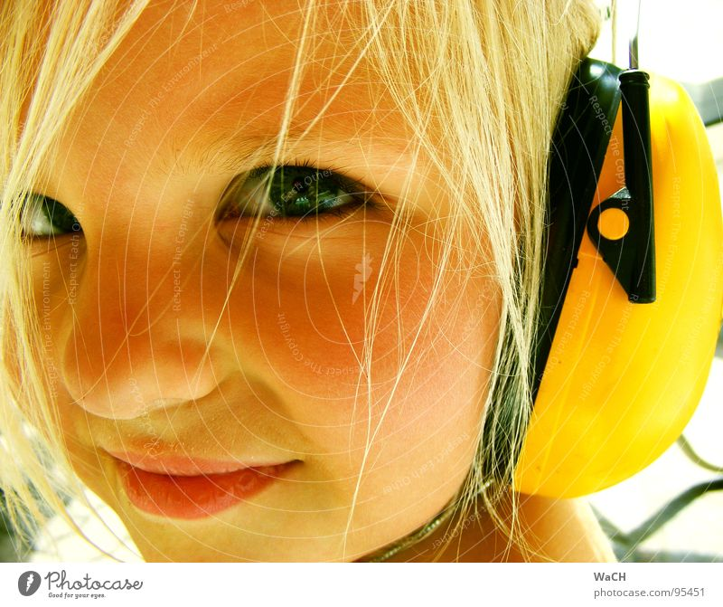 Child Girl Summer Eyes Yellow Face Mouth Bright Blonde Listening Looking Toddler Headphones Seasons Ear protectors