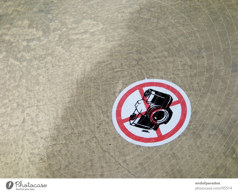 Street Gray Signs and labeling Concrete Floor covering Camera Warning label Strange Bans Label Warning sign Illogical