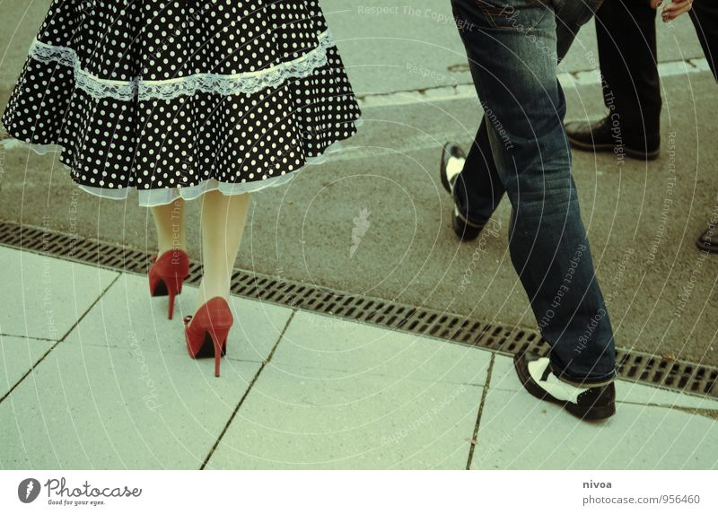 Human being Woman Man City Red Eroticism Adults Street Feminine Lanes & trails Style Legs Going Feet Fashion Couple