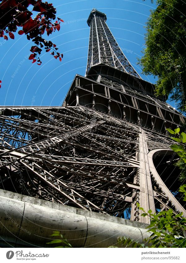 Eiffel Tower Paris Perspective from pedestal to tip France Pedestal Gray Historic Might Towering Landmark Monument Point Metal Blue Sky Gustave Eiffel