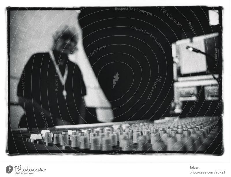 the technician Technician Mixing desk Live Lie Concert Outdoor festival Stage Buttons Electrical equipment Event Media Concentrate Black & white photo