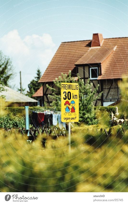 Village idyll Transport Traffic infrastructure Signs and labeling Human being 30 km/h Blue sky Respect Street Idyll of one's own free will
