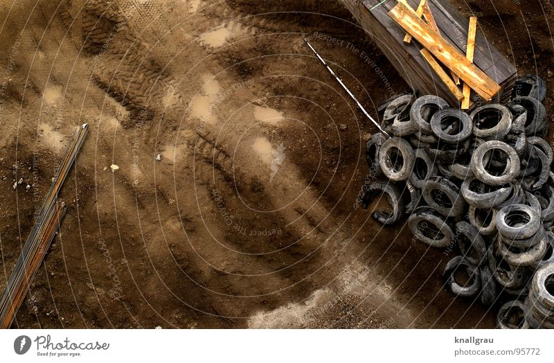 Traces in the sand Construction site Rod Wooden board Rubber Skid marks Construction machinery Dismantling Garbage dump Renewal Minimum wage Construction worker