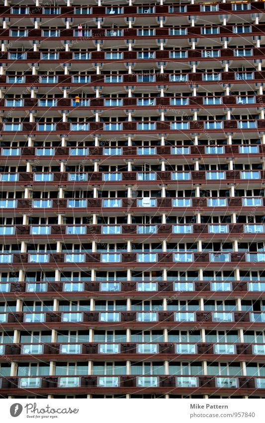 Wall of Balcony House (Residential Structure) High-rise Manmade structures Building Sit Stand Aggression Large Blue Brown Colour photo Exterior shot Evening