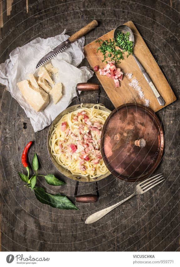 Spaghetti carbonara in a copper pot, served rustically Food Meat Sausage Dough Baked goods Soup Stew Herbs and spices Cooking oil Nutrition Lunch Dinner Banquet
