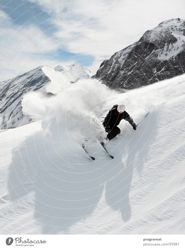 Freeriding on the Kitzsteinhorn Winter Skier Skiing Winter sports Deep snow Hohen Tauern NP White Dangerous Cold Hard Wind Austria Exterior shot Portrait format