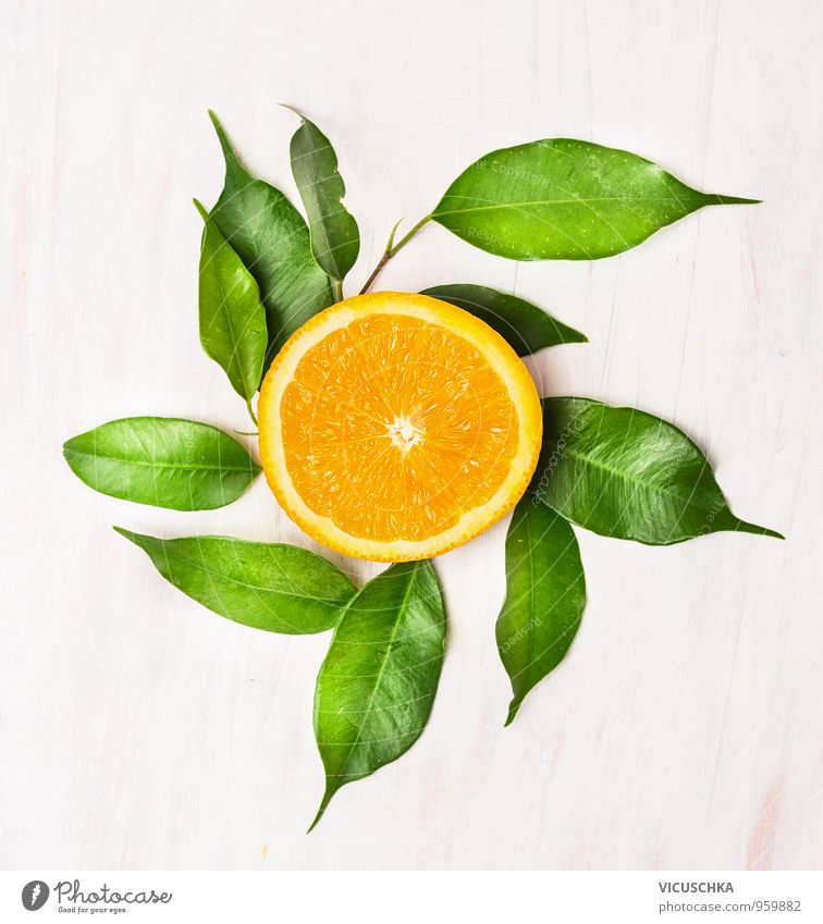 Orange lobules with green leaves on white wooden table Food Fruit Nutrition Buffet Brunch Banquet Organic produce Vegetarian diet Diet Lifestyle Design