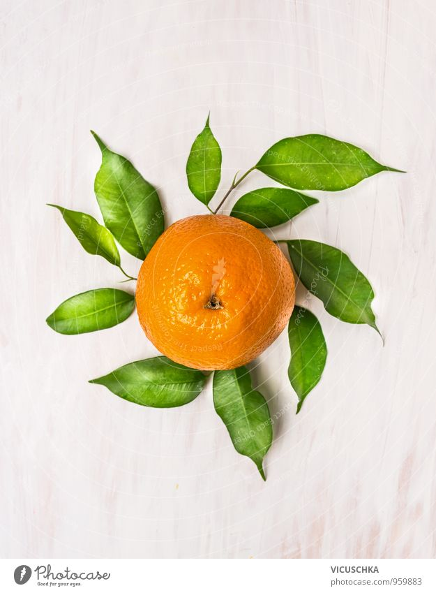 Orange fruit with green leaves on white wood Food Fruit Nutrition Organic produce Vegetarian diet Diet Juice Style Design Healthy Eating Life