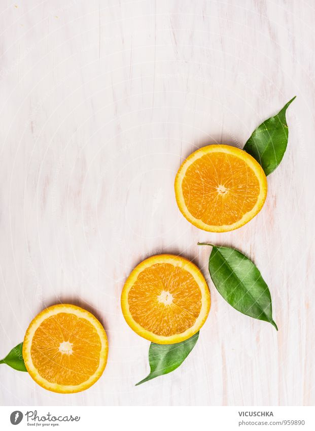 Cutting orange, fruits with leaves Food Fruit Orange Nutrition Breakfast Organic produce Vegetarian diet Diet Juice Style Design Summer Nature Yellow