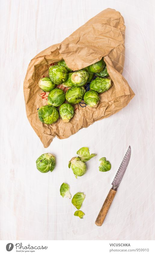 Brussels sprouts in paper bags on white wooden table Food Vegetable Nutrition Organic produce Vegetarian diet Diet Knives Style Winter Nature Design fresh