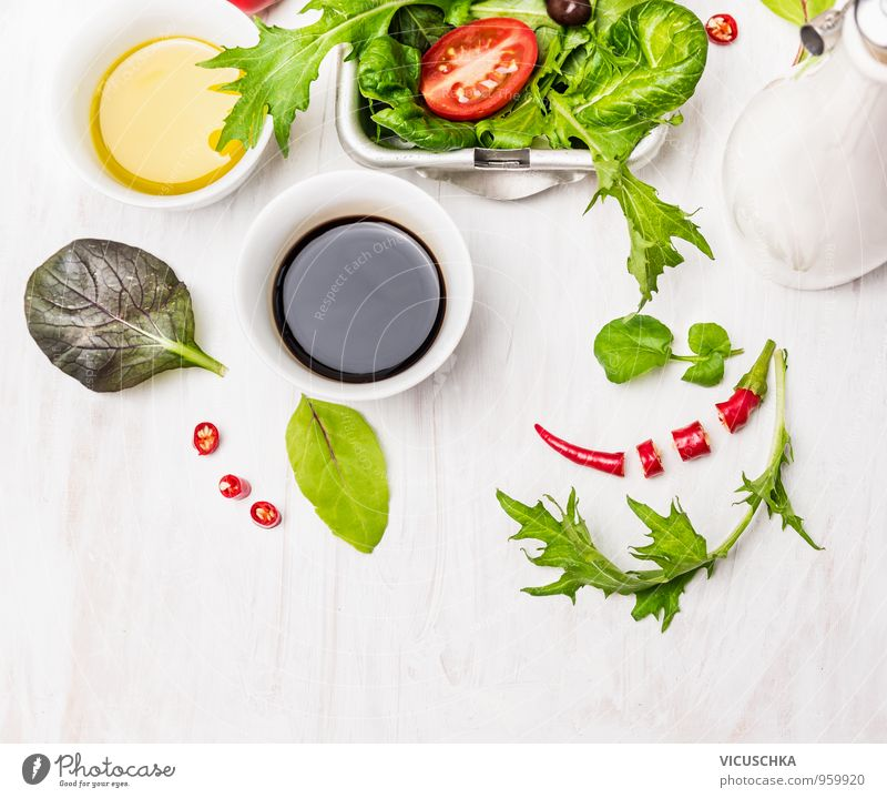 Salad preparation with oil and balsamico on a white wooden table Food Vegetable Lettuce Herbs and spices Cooking oil Nutrition Lunch Buffet Brunch