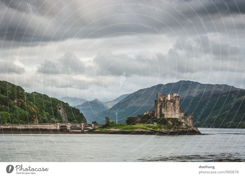 Eilean Donan Castle Environment Nature Landscape Sky Clouds Spring Bad weather Hill Coast Lakeside Manmade structures Building Tourist Attraction Old Famousness