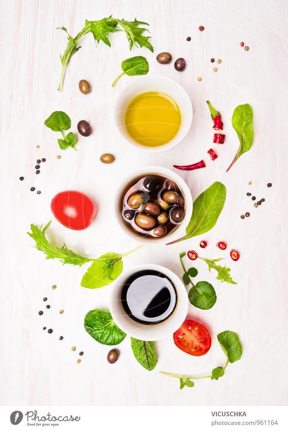 Salad preparation with dressings, olives, wild herbs, chilli, oil Food Vegetable Lettuce Herbs and spices Cooking oil Nutrition Lunch Dinner Buffet Brunch