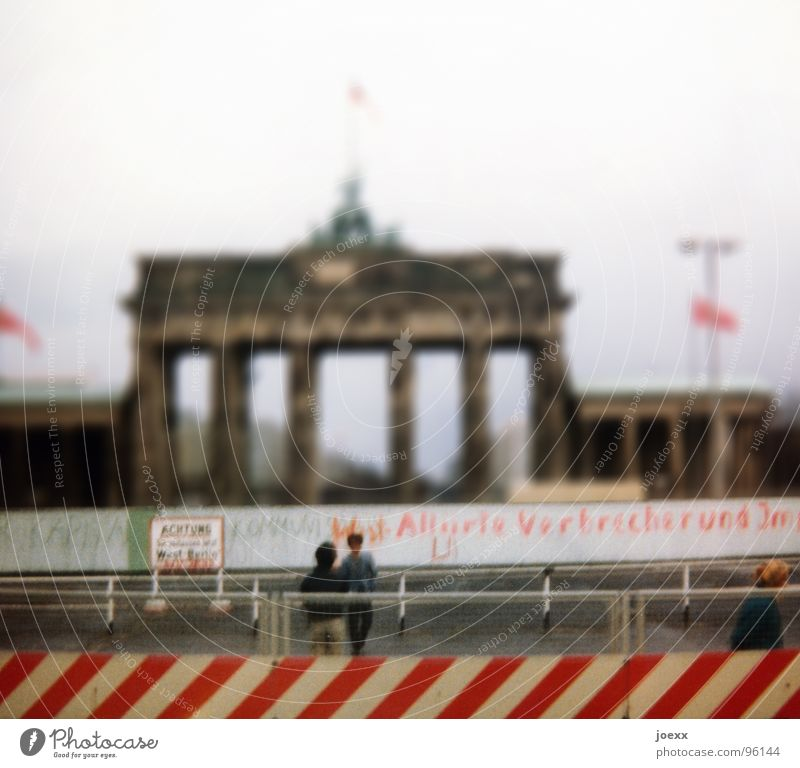 Human being Woman Man Old Adults Wall (building) Feminine Sadness Berlin Freedom Wall (barrier) Couple Dream Masculine Gloomy Change