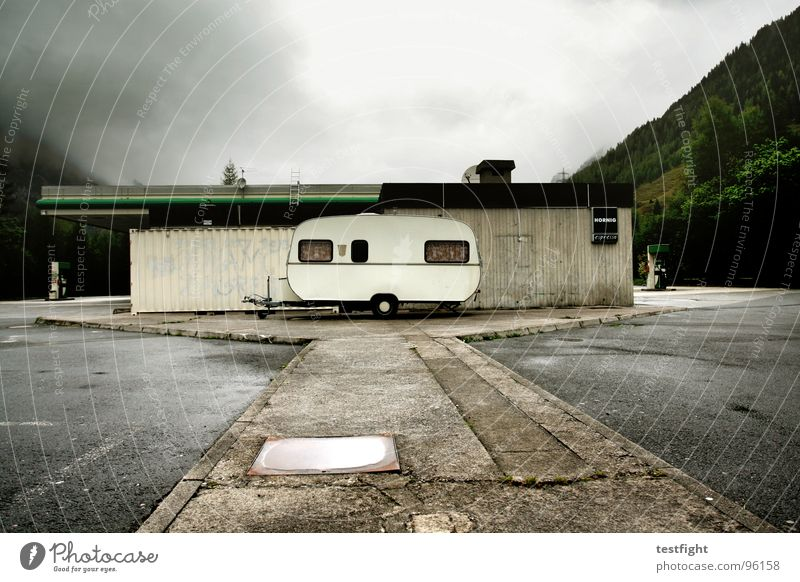 caravans Vacation & Travel Bad weather Damp Wet Cold Petrol station Parking lot Break Hold Mountain Clouds Rain cloudy mountains