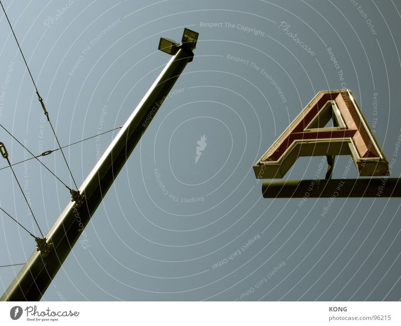 Sky Blue Lamp Beginning Characters Letters (alphabet) Advertising Beautiful weather Typography Electricity pylon Transmission lines Graphic Great Sky blue