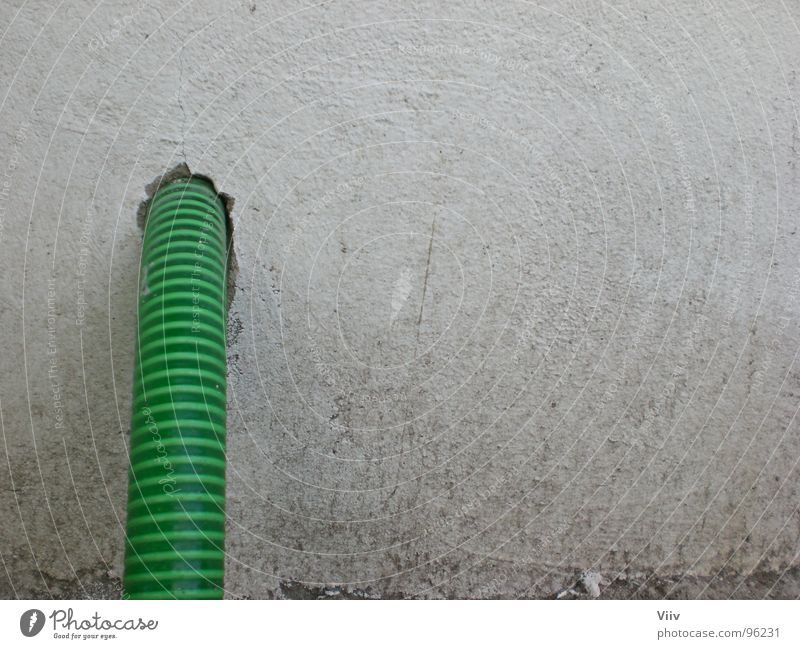 hose Hose Wall (building) Stripe Green White Dirty Plaster Garden hose Pattern Obscure Hollow Structures and shapes Colour