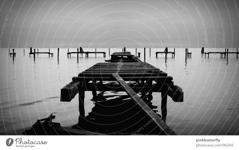 In the footsteps of transience... Lake Ocean Footbridge Jetty Coast Black White Fog Sea level Wood Broken Transience Water reflection Bridge Black & white photo