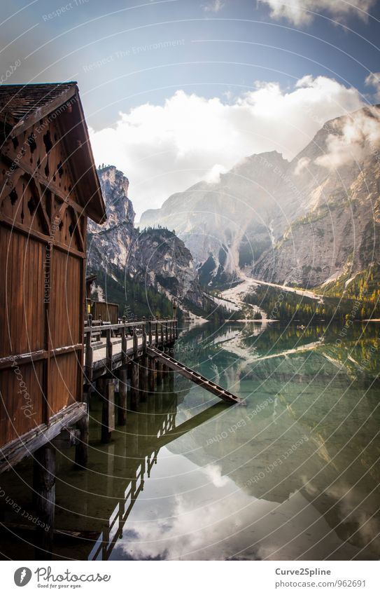 mirror image Nature Elements Water Sky Clouds Beautiful weather Mountain Peak Lakeside Authentic Dolomites Pragser Wildsee Lake Wood Wooden house Wooden hut Hut