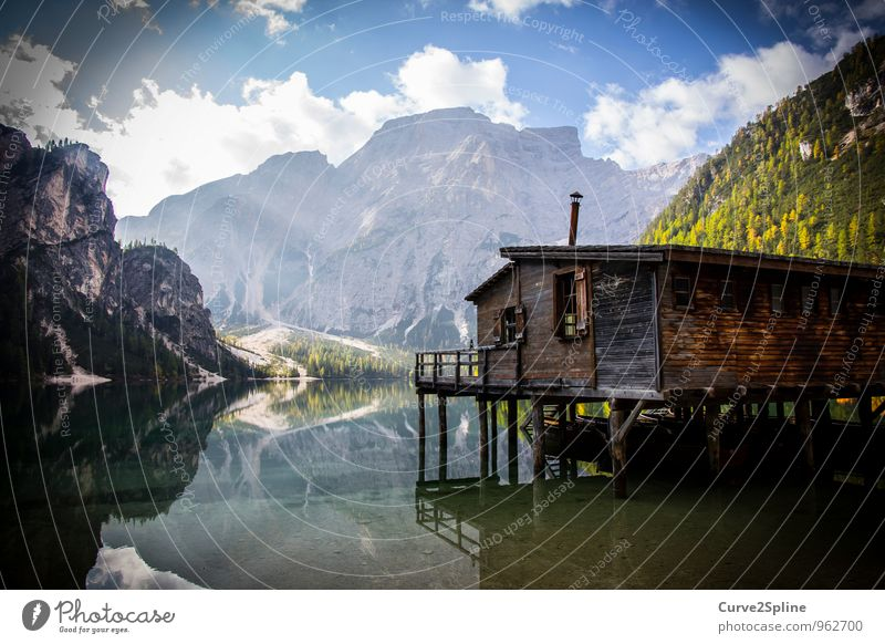 house on the lake Nature Landscape Elements Water Sky Clouds Beautiful weather Rock Mountain Peak Lakeside Village Deserted House (Residential Structure) Hut