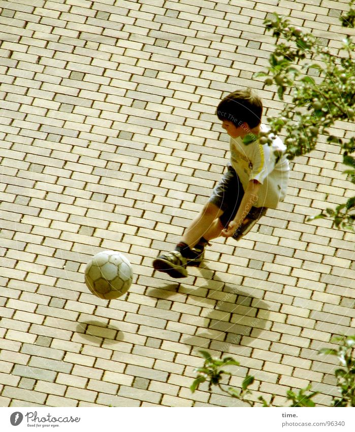 Street Sports Playing Boy (child) Soccer Aviation Human being Child Joie de vivre (Vitality) Dynamics Sneakers Lust Backyard Leather Soccer player