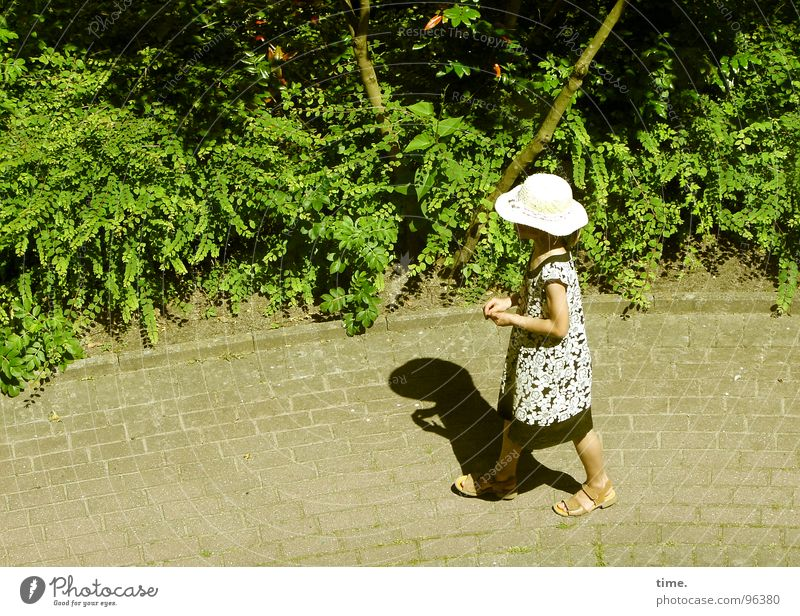 Walking By Myself Shadow Summer Sun Girl Foliage plant Lanes & trails Dress Hat Loneliness Sandal Cobblestones bush