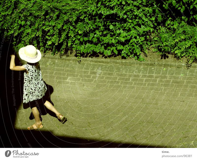 Girl Sun Summer Loneliness Garden Lanes & trails Dress Hat Cobblestones Foliage plant Sandal