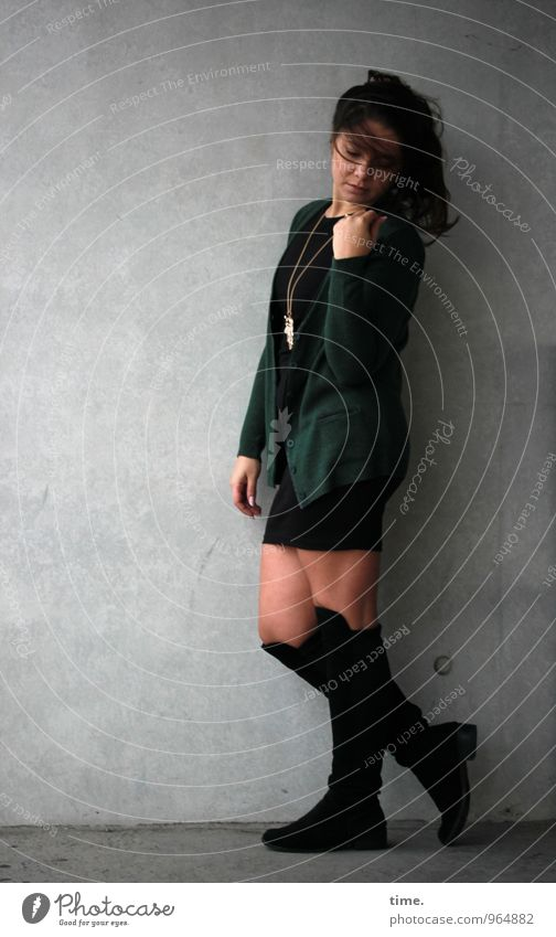 . Feminine Young woman Youth (Young adults) 1 Human being Wall (barrier) Wall (building) Skirt Jacket Jewellery Boots Brunette Long-haired Movement Looking
