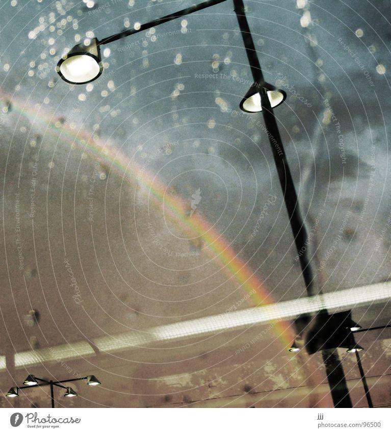 Sky Clouds Rain Weather Drops of water Transport Railroad Lantern Train station Window pane Rainbow Treasure