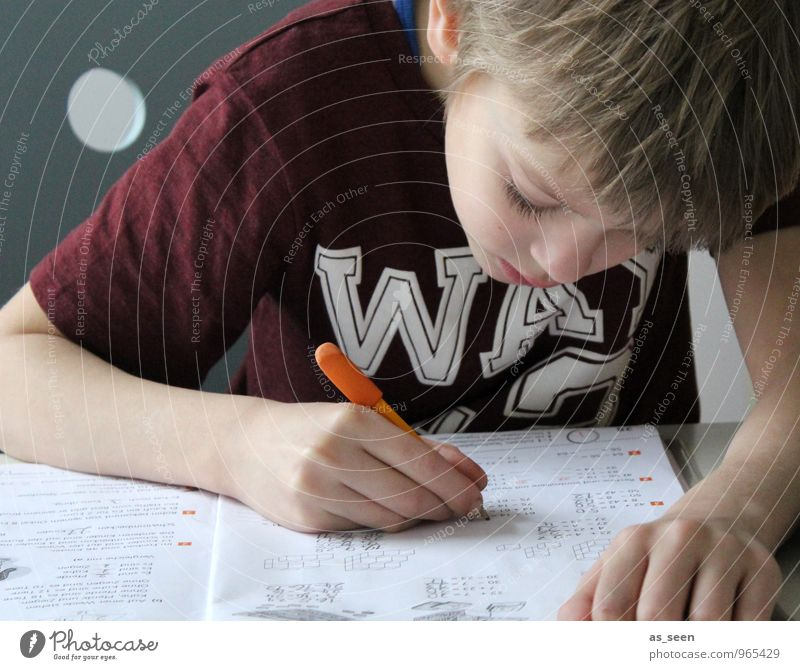 homework Boy (child) Infancy Life Hand Fingers 1 Human being 3 - 8 years Child T-shirt Blonde Stationery Paper Piece of paper Pen Booklet Sign Characters