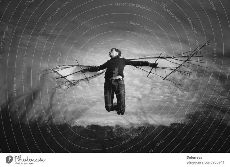 high up Human being Masculine Man Adults 1 Clouds Horizon Autumn Flying Dream Fantastic Willpower Brave Wing Black & white photo Exterior shot Full-length