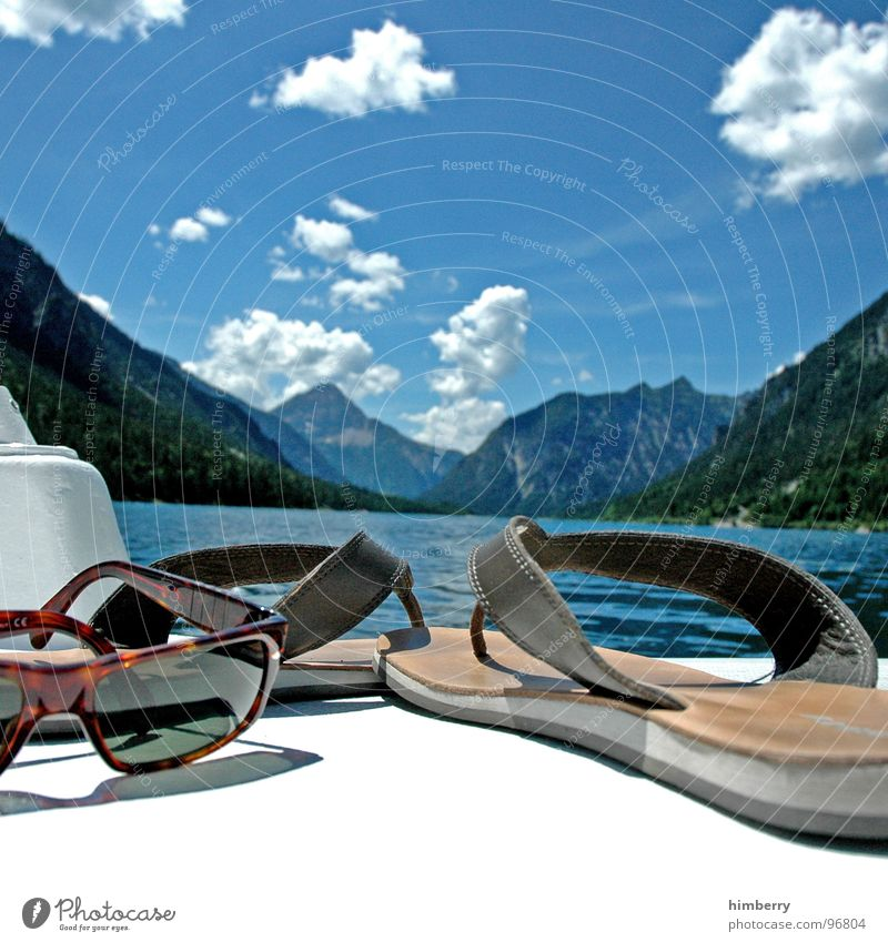 Sky Water Summer Clouds Playing Mountain Lake Watercraft Swimming & Bathing Leisure and hobbies Eyeglasses Sunglasses Flip-flops