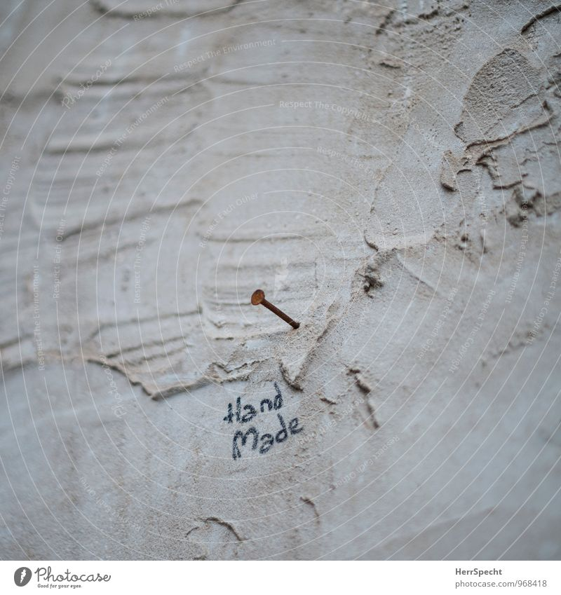 Art | Hand | Work Deserted Manmade structures Building Wall (barrier) Wall (building) Stone Concrete Characters Graffiti Funny Brown Nail Rust Work of art