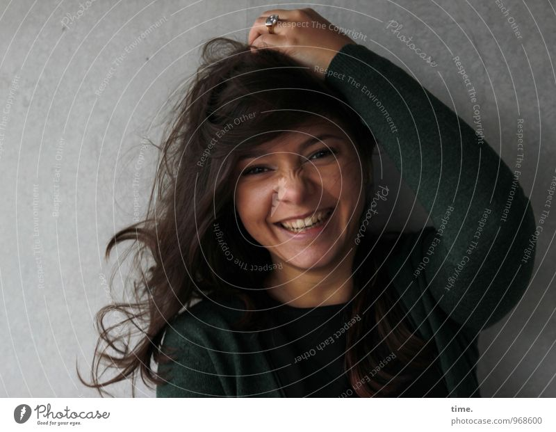. Feminine Young woman Youth (Young adults) 1 Human being Wall (barrier) Wall (building) Cardigan Ring Brunette Long-haired Curl Laughter Beautiful Emotions Joy