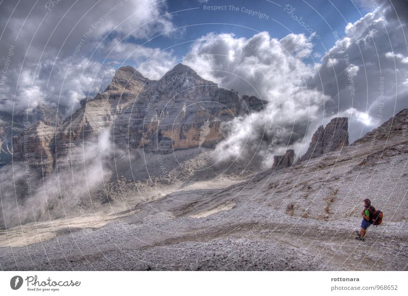 tofans Tourism Trip Freedom Mountain Hiking dolomites South Tyrol ladinia trekking 1 Human being Clouds Summer Fog Rock Alps Peak Backpack Cap Stand Fantastic