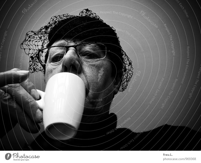 at the edge of the coffee cup Beverage Espresso Cup Restaurant Human being Woman Adults Female senior Head Hand 1 45 - 60 years Eyeglasses Hat Drinking Old