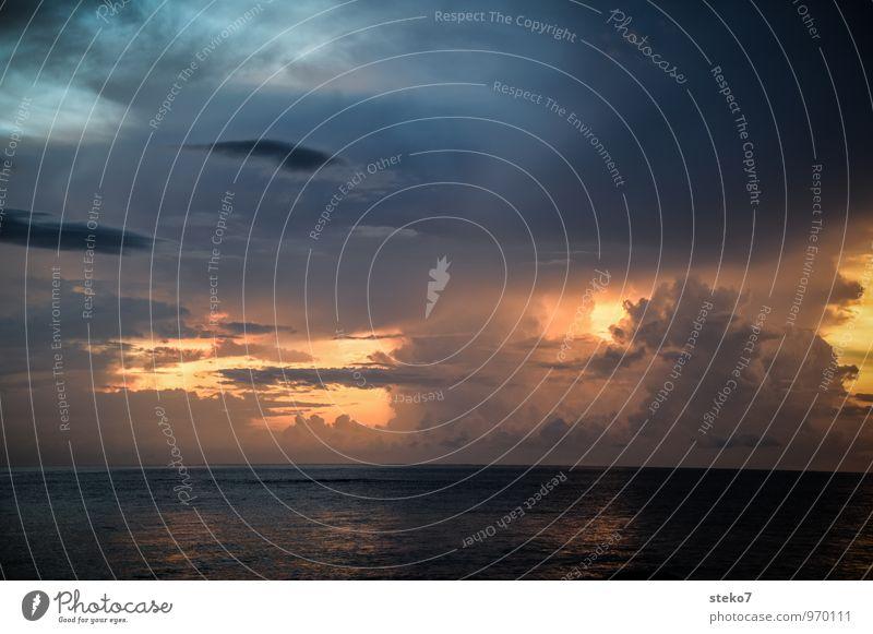 Blue Ocean Dark Gray Horizon Gold Threat Storm clouds Andaman Sea