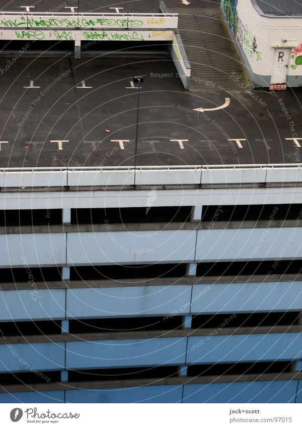 orphaned parking spaces on multi-storey car park II Parking garage Architecture Graffiti Arrow Tall Modern Gloomy Loneliness Multi-story garage Ramp Garage