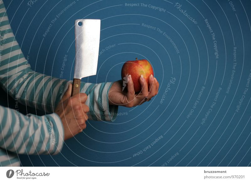 Apple basher Food Fruit Nutrition Vegetarian diet Diet Fasting cleaver Knives Fitness Sports Training Kitchen Arm Hand 1 Human being Eating Fresh Healthy Blue