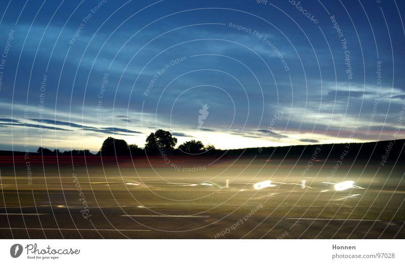 auto exposure Night Twilight Light Tree Bushes Rear light Brake light Exposure Red White Clouds Horizon Driving Speed Median strip Traffic lane Tar Asphalt