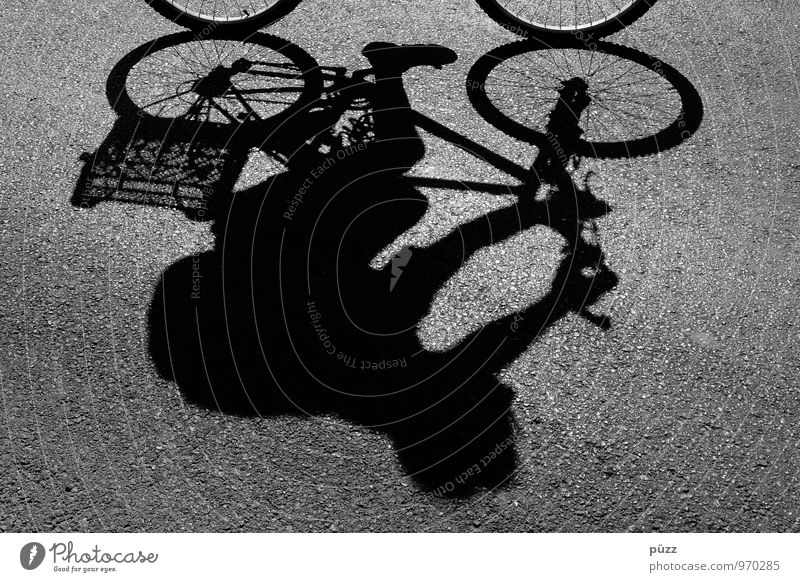 shadow-wheeler Cycling tour Bicycle 1 Human being Town Downtown Transport Means of transport Street Lanes & trails Movement Driving Healthy Athletic Gray Black