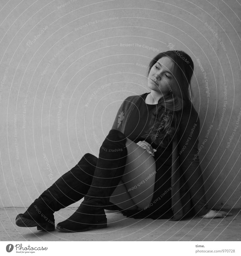. Feminine Young woman Youth (Young adults) 1 Human being Wall (barrier) Wall (building) Skirt Jacket Boots Brunette Long-haired Observe Think Looking Sit