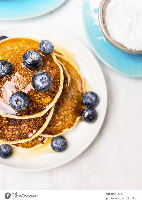 Sweet pancakes with blueberries and syrup. Food Fruit Dough Baked goods Dessert Nutrition Breakfast Organic produce Vegetarian diet Diet Crockery Plate Style