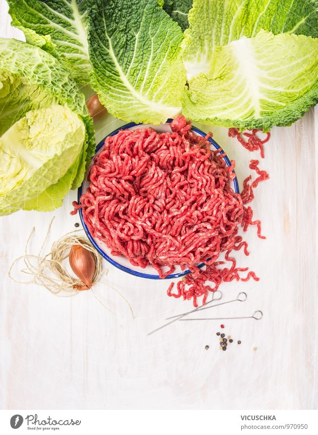 Raw minced meat and savoy cabbage cabbage leaves. Food Meat Vegetable Herbs and spices Nutrition Lunch Dinner Organic produce Diet Bowl Style Design