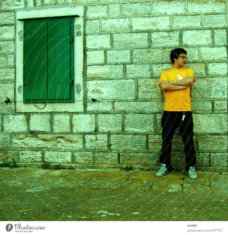 in spite of oneself Croatia Man University & College student Wall (barrier) House (Residential Structure) Defiant Cool (slang) Wall (building) Anger Aggravation