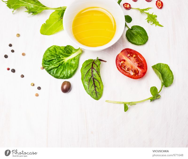 Salad leaves with dressing, olives and tomatoes Food Vegetable Lettuce Herbs and spices Cooking oil Nutrition Banquet Organic produce Vegetarian diet Diet Bowl